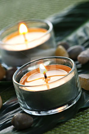 Candles stock photo, Burning candles in glass holders on green leaf by Elena Elisseeva