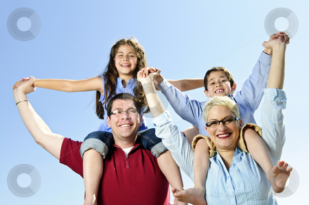 Happy family fun stock photo, Happy family having fun giving shoulder rides by Elena Elisseeva