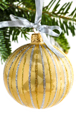 Christmas ornament stock photo, Golden Christmas decoration hanging on pine branch isolated on white by Elena Elisseeva