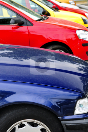 Row of parked cars stock photo, Row of cars in parking lot on a bright day by Elena Elisseeva