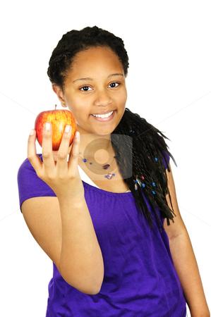 Girl holding apple stock photo, Isolated portrait of black teenage girl holding apple by Elena Elisseeva
