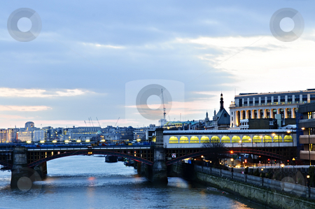 View on Thames river at nighttime, London stock photo, View of bridge and cityscape on Thames river in London at night by Elena Elisseeva