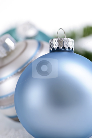 Christmas ornaments stock photo, Closeup of three Christmas decorations sitting in snow by Elena Elisseeva