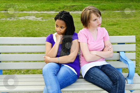 Bored teenage girls stock photo, Two bored teenage girls sitting on bench by Elena Elisseeva