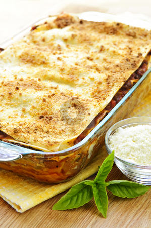 Lasagna stock photo, Fresh baked lasagna casserole with grated parmesan cheese by Elena Elisseeva