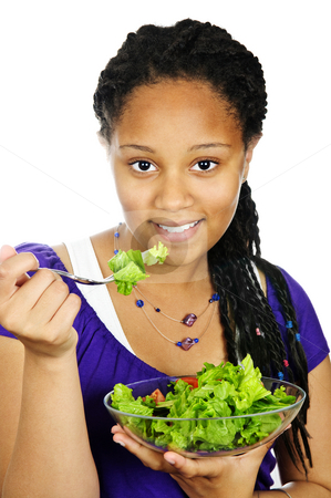 Girl having salad stock photo, Isolated portrait of black teenage girl with salad bowl by Elena Elisseeva