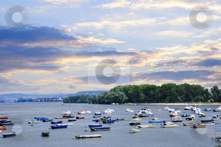 River boats on Danube stock photo, Many small fishing boats anchored on Danube river. View from Zemun part of Belgrade. by Elena Elisseeva