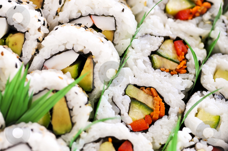 Sushi platter stock photo, Close up on tray of assorted sushi appetizers by Elena Elisseeva