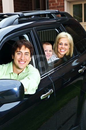 Happy family in car stock photo, Happy young family sitting in black car looking out windows by Elena Elisseeva