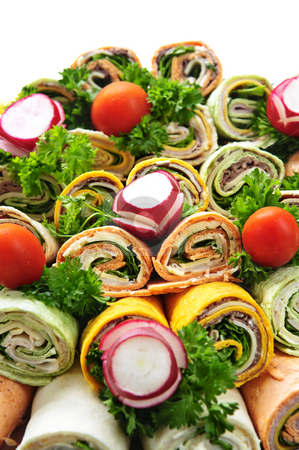 Sandwich tray stock photo, Closeup on platter of assorted meat tortilla wraps by Elena Elisseeva