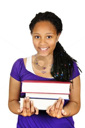 Girl holding text books stock photo, Isolated portrait of black teenage girl holding text books by Elena Elisseeva