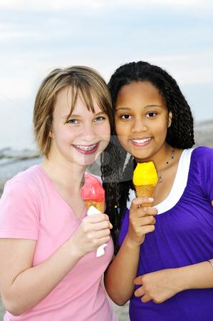 Girls having ice cream stock photo, Portrait of two teenage girls eating ice cream cones by Elena Elisseeva