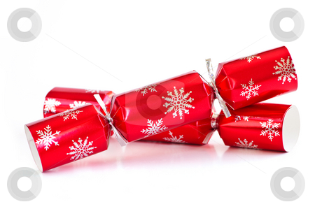 Christmas crackers stock photo, Two red Christmas crackers isolated on white by Elena Elisseeva
