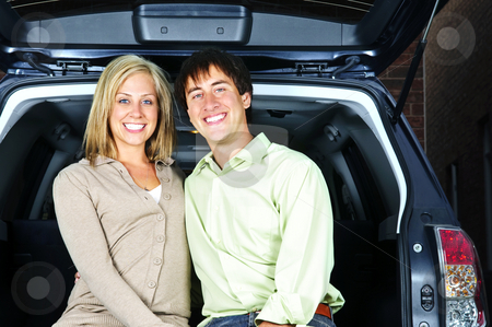Couple sitting in back of car stock photo, Happy young couple sitting at back of car by Elena Elisseeva