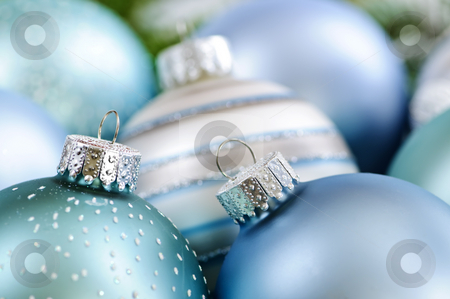 Christmas ornaments stock photo, Many Christmas decorations in snow with pine branches by Elena Elisseeva