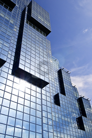 Modern glass building stock photo, Modern geometric city building reflecting sun and clouds by Elena Elisseeva