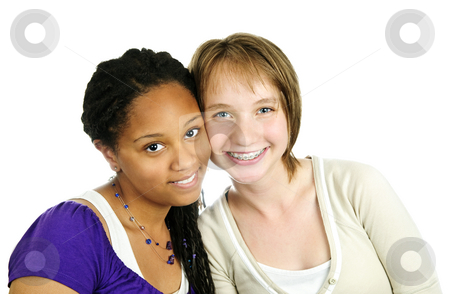 Two girlfriends stock photo, Isolated portrait of two diverse teenage girl friends by Elena Elisseeva