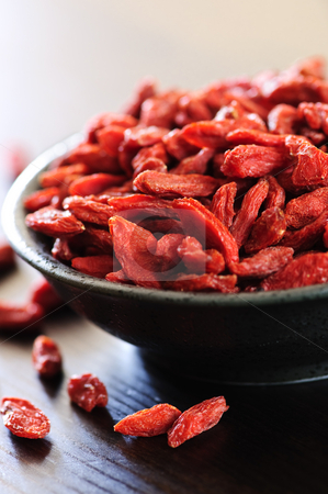 Goji berries stock photo, Full bowl of red dried goji berries by Elena Elisseeva