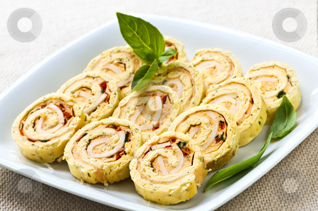Mini sandwich spiral roll appetizers stock photo, Plate of many mini bite size sandwich appetizers by Elena Elisseeva