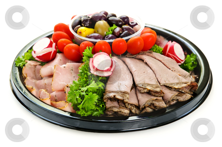 Cold cut platter stock photo, Isolated platter of assorted cold cut meat slices by Elena Elisseeva