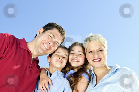 Happy family portrait stock photo, Portrait of happy family of four smiling by Elena Elisseeva