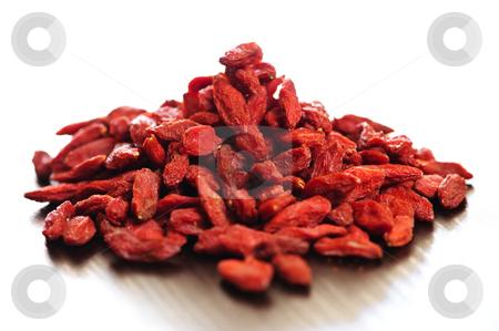Goji berries stock photo, Loose pile of red dried goji berries by Elena Elisseeva