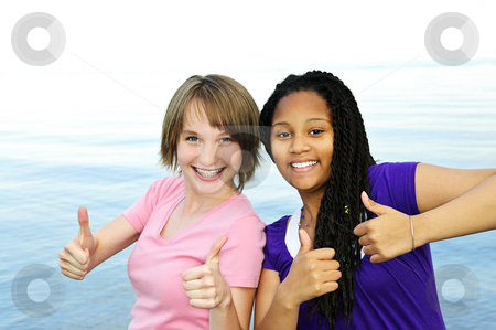 Happy girlfriends stock photo, Portrait of two teenage girl friends showing thumbs up by Elena Elisseeva