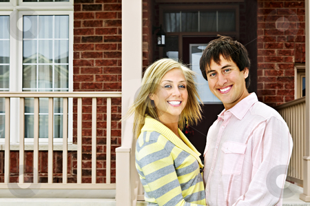 Happy couple at home stock photo, Young happy couple in love at home by Elena Elisseeva