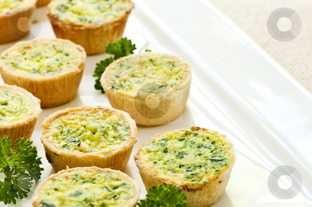 Mini quiches stock photo, Plate of many mini bite size quiche appetizers by Elena Elisseeva