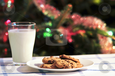 Milk and cookies for Santa stock photo, Plate of cookies and glass of milk near Christmas tree by Elena Elisseeva