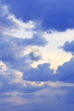 Stormy sky with sunshine stock photo, Stormy sky with sun shining through clouds by Elena Elisseeva