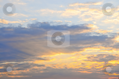 Sunset sky stock photo, Blue sky at sunset with sunbeams and bright clouds by Elena Elisseeva