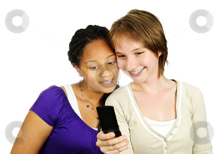 Teen girls with mobile phone stock photo, Isolated portrait of two teenage girls with cell phone by Elena Elisseeva