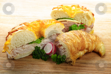 Sandwiches stock photo, Assorted bagel and croissant sandwiches with meat and vegetables by Elena Elisseeva