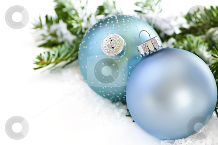 Christmas ornaments stock photo, Two Christmas decoration in snow with pine branches by Elena Elisseeva