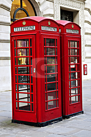 Telephone boxes in London stock photo, Two red telephone boxes near on London sidewalk by Elena Elisseeva