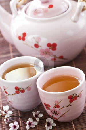 Green tea set stock photo, Green tea set with teapot and cups by Elena Elisseeva