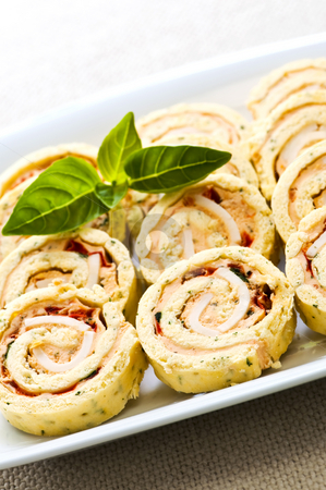 Mini sandwich spiral roll appetizers stock photo, Plate of many mini bite size sandwich appetizers by Elena Elisseeva