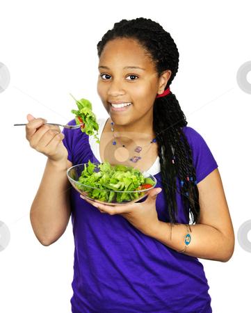 Girl having salad stock photo, Isolated portrait of black teenage girl with salad bowl by Elena Elisseeva