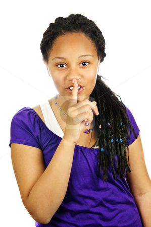 Teenage girl stock photo, Isolated portrait of black teenage girl gesturing for quiet by Elena Elisseeva