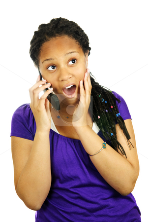 Teen girl with mobile phone stock photo, Isolated portrait of surprised teenage girl with cell phone by Elena Elisseeva