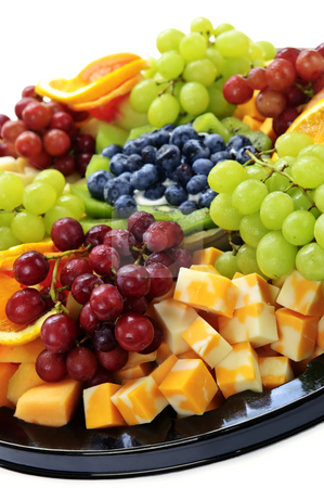 Fruit tray stock photo, Platter of assorted fresh fruit and cheese by Elena Elisseeva