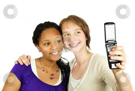Teen girls with camera phone stock photo, Isolated portrait of two teenage girls with camera phone by Elena Elisseeva