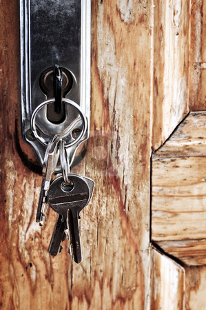 Keys in lock stock photo, Set of keys in lock of old wooden door by Elena Elisseeva
