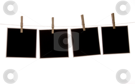 Polaroid stock photo, Photographs in front of a white background, hanging from clothes line. by Jandrie Lombard