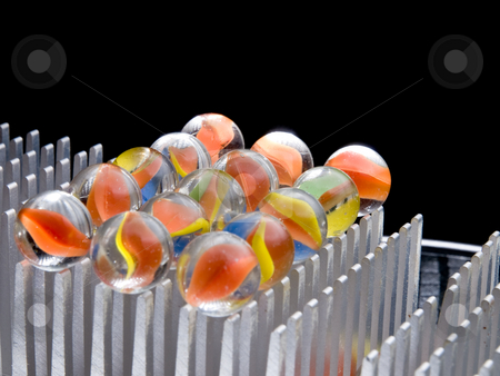 Colored Marbles on grid stock photo, Colored Marbles by Jim DeLillo
