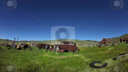Vintage Vehicles in Historical Bodie California stock photo, Field of Vintage Vehicles in Historical Bodie California by Katrina Brown