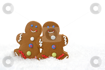 Gingerbread Cookies stock photo, Two gingerbread cookies in snow. There is no one viewable in the image. Horizontally framed shot. by Katrina Brown
