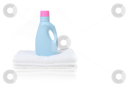 Fabric Softener Detergent Container stock photo, Fabric Softener Detergent Container Sitting on a White Folded Towel With Copy Space by Katrina Brown