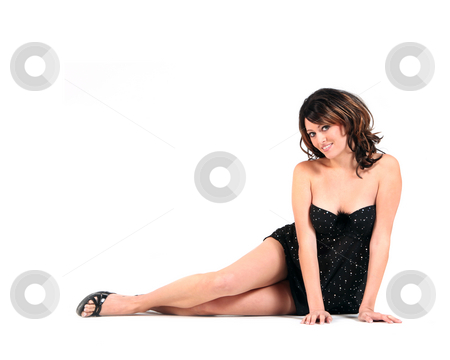 Young Female Model stock photo, A young female model sits with legs outstretched. She is looking at the camera, smiling with full length viewable. Horizontally framed shot. by Katrina Brown